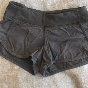 Girl's Ivivva Running Shorts.